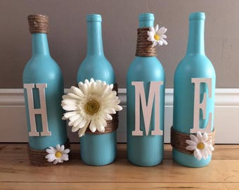 "Wine Bottles Teal that say ""HOME"""