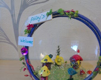 Fairy homes in a glass bauble