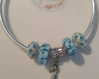 Seahorse and blue bead bangle 19cm