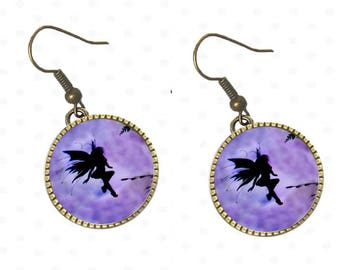 Elves shade earrings cabochon, purple background