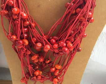 Red eco-necklace with beads of beans