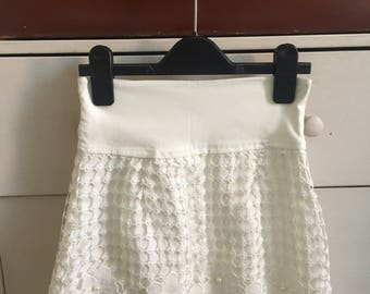 Off-white floral lace mini skirt