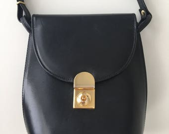 Vintage black shoulder or crossbody leather bag
