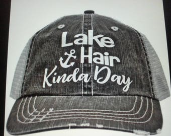 super cute, vintage style, trucker style hat with the saying Lake Hair Kina Day