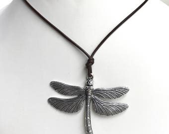 Dragonfly pendant silver toned. Brown leather cord. Adjustable