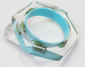 Gorgeous blue lucite bracelet with real glowing insects
