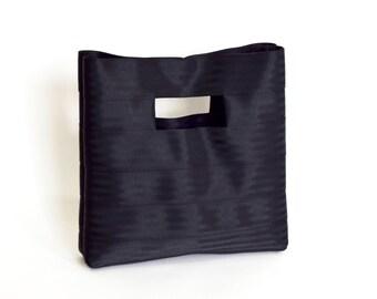 The Hyphen Bag in Black - Black Seatbelt Clutch Purse
