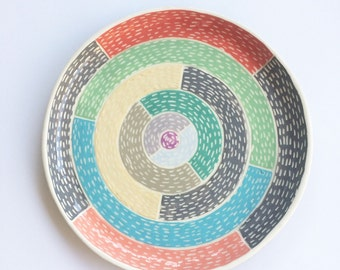 Ceramic platter round geometric pattern carved