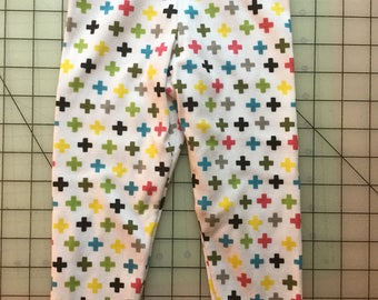 Size 9 Months to 12 Months Baby Leggings - White with Multi-Color Crosses