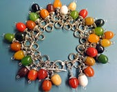 Unique one-of-a-kind charm bracelet with 34 multicolor genuine tested vintage 1940s bakelite charms, silvercolor metal details/ toggle clasp