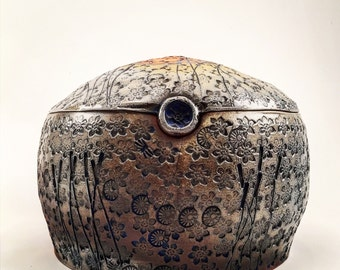 Wood fired Lidded jar with swamp theme