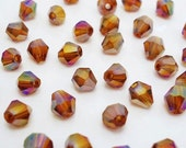 75% OFF SPRING CLEARANCE 100 pieces of 4mm Amber Bicone Ab Crystal Beads