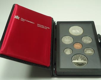 1985 Royal Canadian Mint Double Dollar Uncirculated Specimen 7 Coin Set Indian/Voyager, Coat Of Arms, Caribou, Schooner, Beaver, Maple Leaf