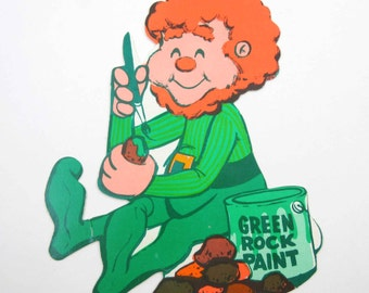 Vintage Cute Leprechaun Boy Painting Rocks with Green Paint Die Cut Decoration for St. Patrick's Day