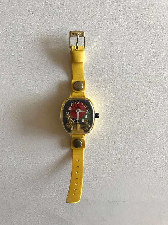 Merry Manufacturing Co. Yellow Teeter Totter Watch (running)