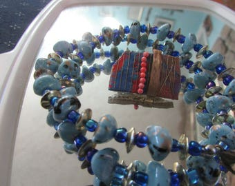 light and dark blue beaded necklace w/ abstract brooch