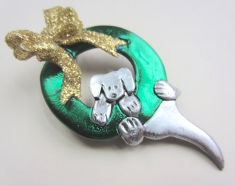 Dog Hanging on a wreath pin brooch
