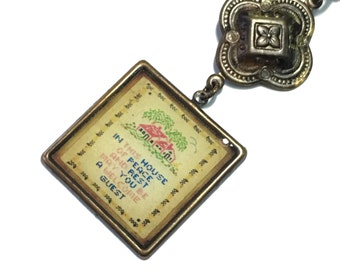 Cross Stitch Sampler Pendant necklace on long brass chain