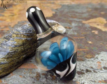 Glass 'Inception' spinning top - Made by FoxGlass - Glass Spin toy - Spinning top with flower inclusion  - Teal sparkle blue Black and White