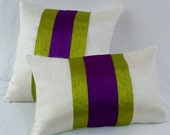 off white art  silk rectangle throw pillow with neatly stitched apple green and purple  center band.       12x 20 inch lumbar pillow