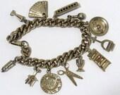Vintage Charm Bracelet, Goldtone Fan Harmonica Scissors Ladder Roulette Wheel Bullet Ashtray