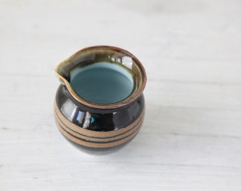 Wheel Thrown  creamer with robin's egg blue interior and brown stripes