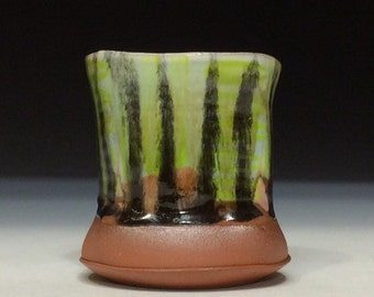 Green and black stripes cup