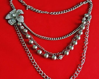 """Vintage silver tone multistrand 28"""" necklace with attached 2""""rhinestone flower pendant in great condition"""