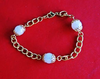 """AVON signed Vintage gold tone 7.5"""" bracelet with pale pink beaded attached charms in great condition, appears unworn"""