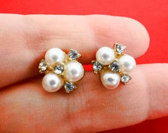"Vintage .5"" gold tone pierced earrings with pearl and rhinestone accents in great condition"