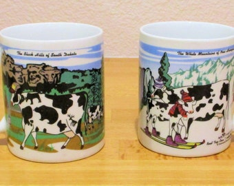 "Cow Mug, ""Road Trip Cows"" series from New Hampshire & South Dakota  set of 2"