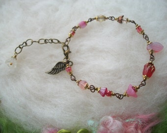 Beaded Bracelet, Pink Glass Beads and Filigree Findings Bronze Wing for Remembrance Beaded Bracelet