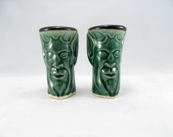 Shot Glasses, a PAIR, carved with Pan's face Green Glaze (2oz) Stoneware Pottery