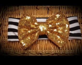 6.50 SALE!!--NB-4T Black and white striped headband with Gold Bow