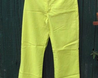 "Capri style lime green pants stretchy with ""V"" hem"