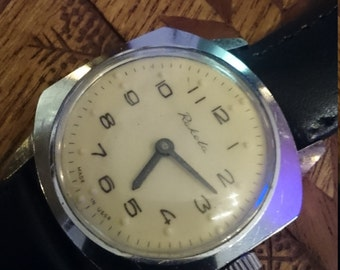 Vintage Russian mechanical wristwatch Raketa from Soviet Union period for blind people