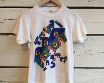 "Vintage 1980s ""Tribal Instinct"" t-shirt • 80s tee • womens shirt"