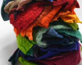 Fabric scraps, handmade wool felt, hand dyed silk and cotton fabrics