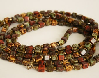 Vintage multi coloured glass bead necklace. Reds and browns. Cube shaped beads.  Long necklace