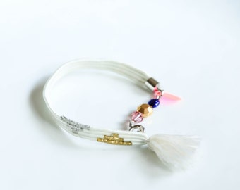 Delicate subtle white silk tassel bracelet with gold and silver thread pattern and vintage beads