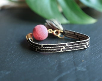 Handmade woven vintage silk tassel bracelet with large pink bead