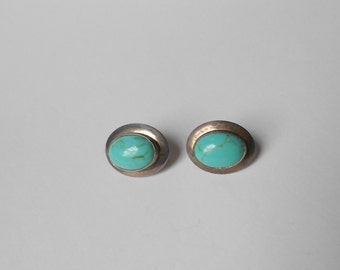Lovely Vintage pair of Sterling Silver & Turquoise earrings with post mounts.