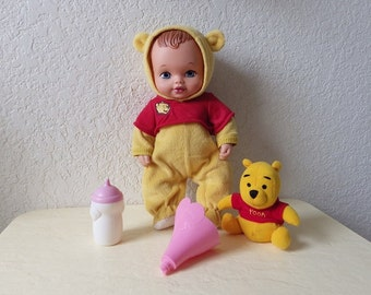 Lauer Water Baby Doll dressed as Winnie the Pooh with Plush Pooh Rattle, Bottle and Funnel  1990.