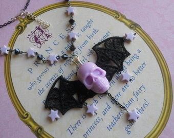skull bat necklace with stars pastel goth lavender
