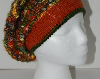 Slouchy hat in green and rust colors