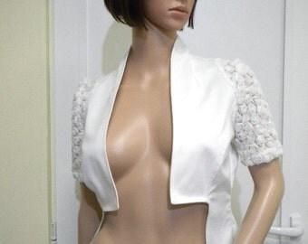 Stylish white ladies bolero with 3 D lace.