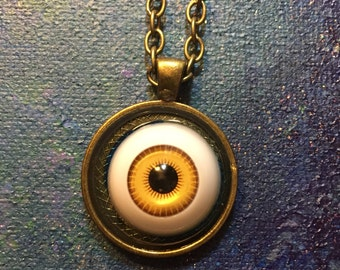 Yellow Doll's Eye Pendant on Bronze Tone Chain