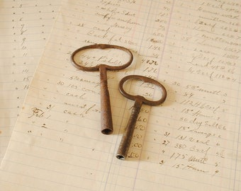 Pair of vintage French clock keys