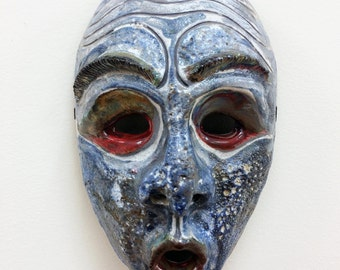 Mask with Red Eyes