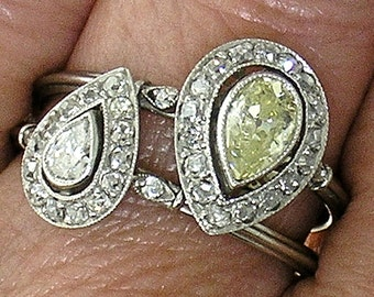 LIGHT FANCY YELLOW Pear Shape Diamond in Platinum Mounting with Matching Smaller Ring